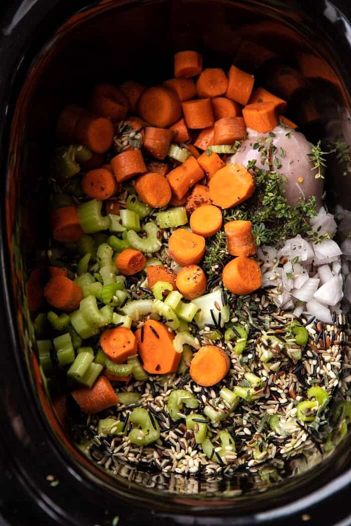 overhead photo of soup ingredients in slow cooker before cooking