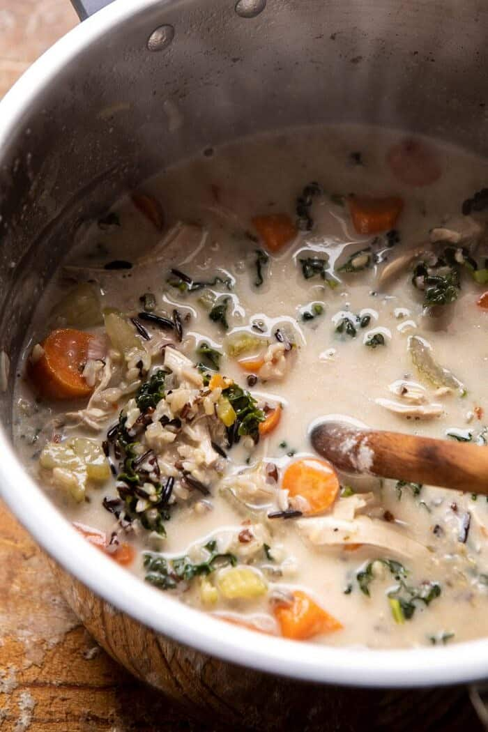 overhead photo of Creamy Wild Rice Chicken Soup in slow cooker after cooking