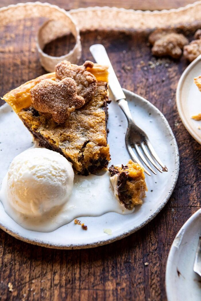 overhead photo of Gooey Chocolate Chip Cookie Pumpkin Pie slice with ice cream on plate