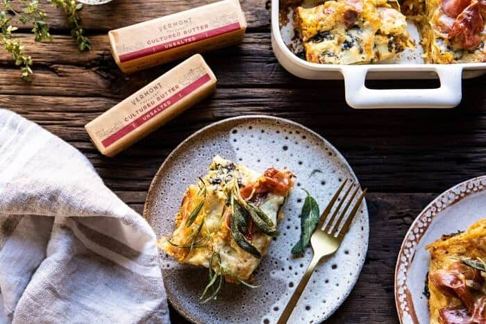 horizontal photo of Roasted Butternut Squash and Spinach Lasagna slice on serving plate with fork