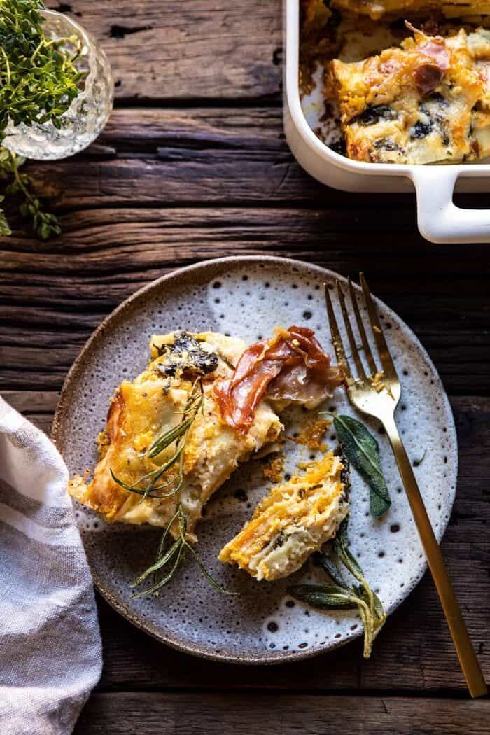 overhead photo of Roasted Butternut Squash and Spinach Lasagna slice on serving plate with fork