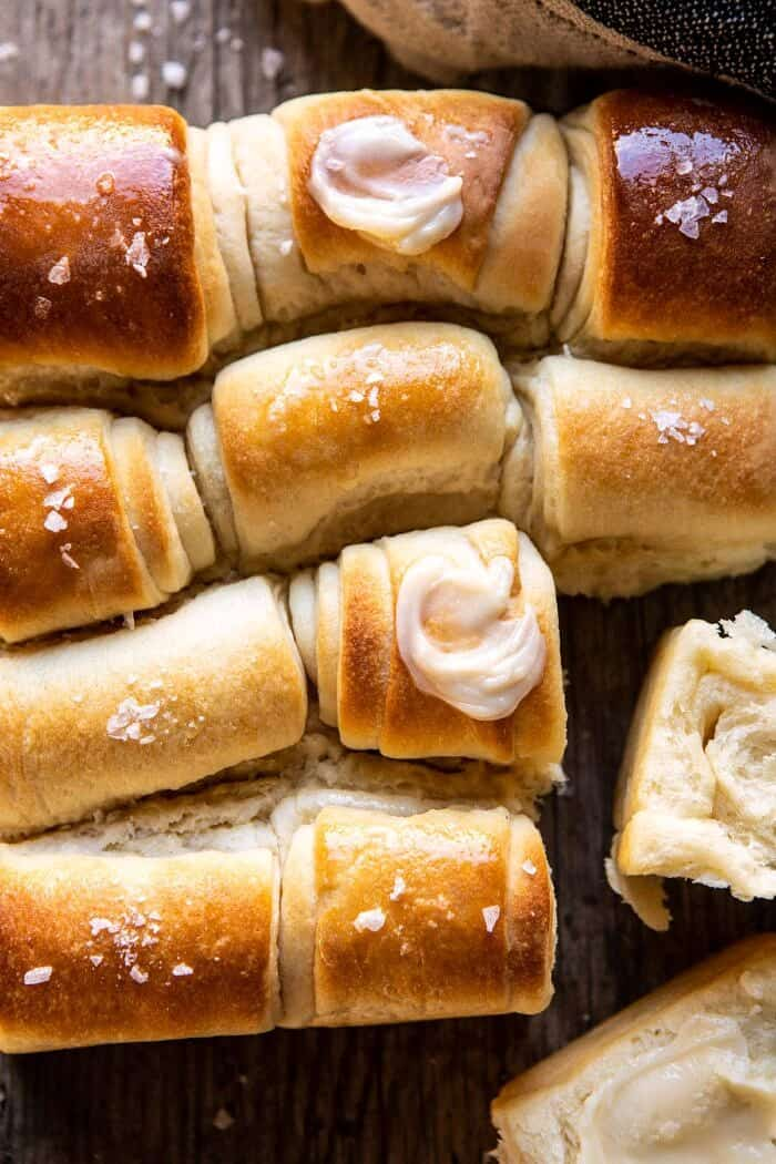 overhead close up photo of Salted Honey Butter Parker House Rolls