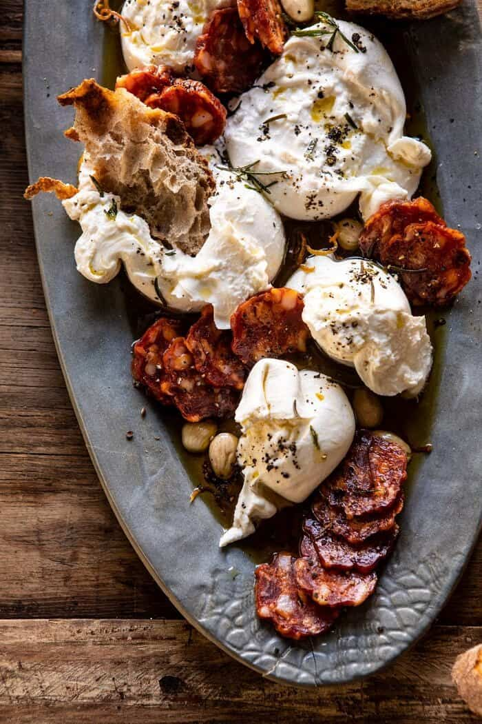 overhead close up photo of Burrata with Lemon Pepper Salami Bites on serving plate
