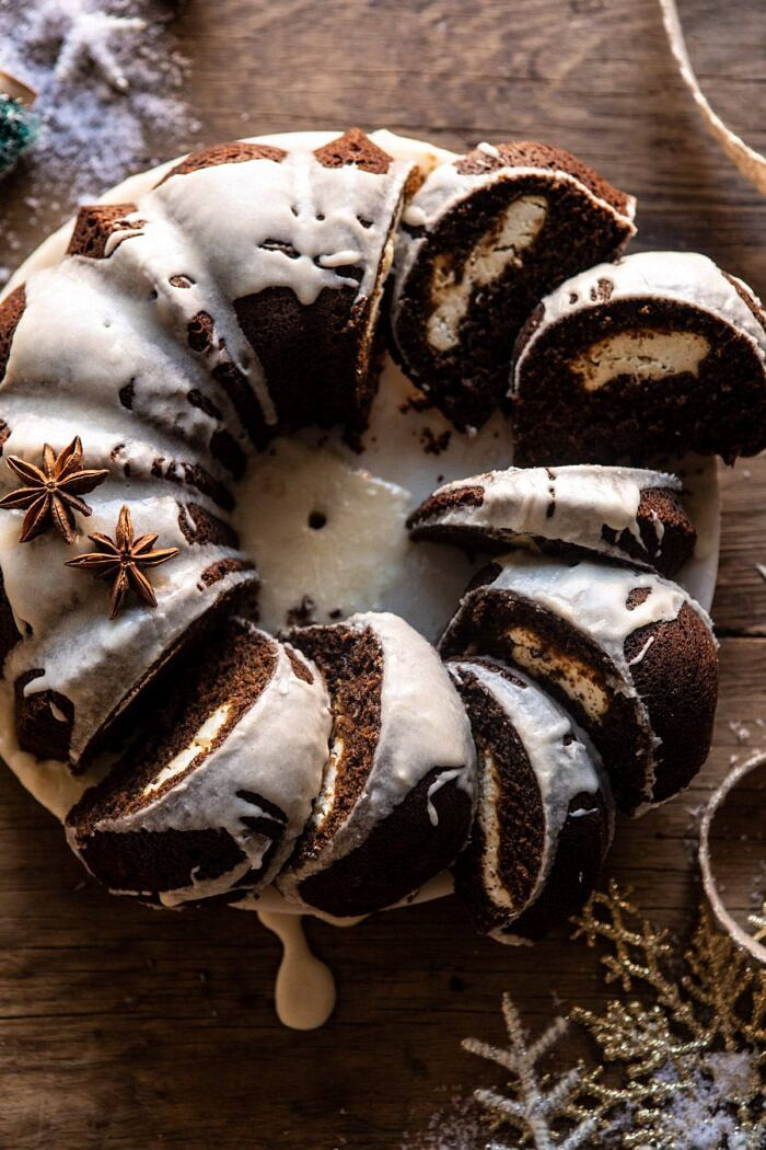 overhead close up photo of Cream Cheese Swirled Chai Gingerbread Cake with multiple slices of cake cut