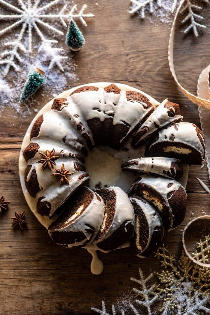 overhead photo of Cream Cheese Swirled Chai Gingerbread Cake with multiple slices of cake cut