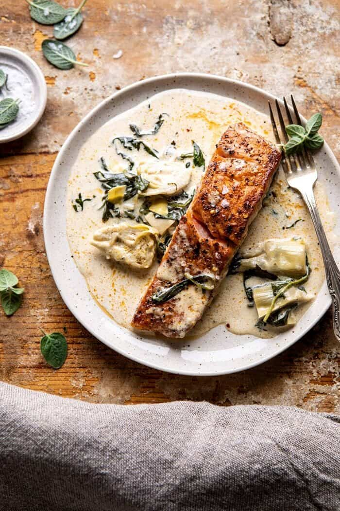Creamy Spinach and Artichoke Salmon | halfbakedharvest.com #salmon #garlicbutter #easyrecipes