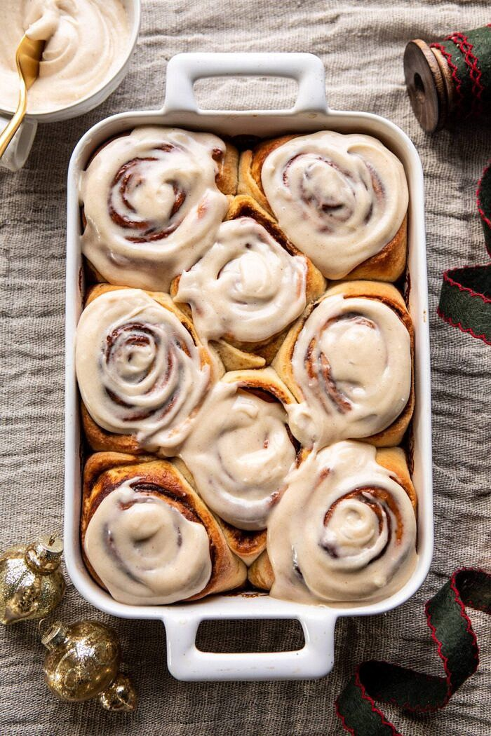 overhead photo of Easy Gingerbread Brioche Cinnamon Rolls with frosting on rolls