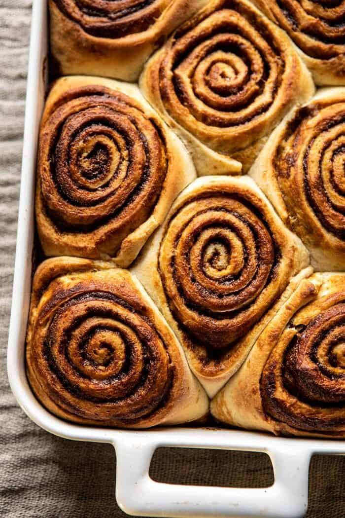 overhead close up photo of Easy Gingerbread Brioche Cinnamon Rolls before adding frosting