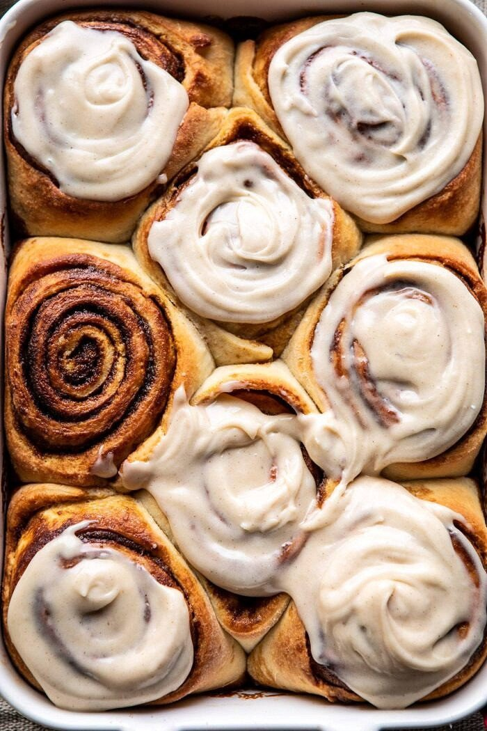 overhead close up photo of Easy Gingerbread Brioche Cinnamon Rolls in baking dish