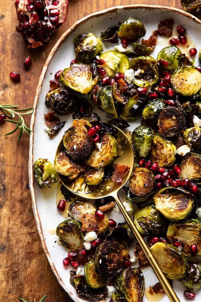 overhead close up photo of Roasted Bacon Brussels Sprouts with Salted Honey with spoon on plate