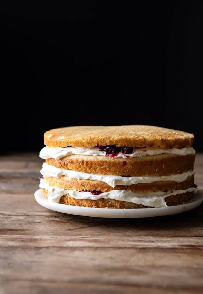 side angled photo of White Christmas Cranberry Layer Cake before frosting the outside of the cake