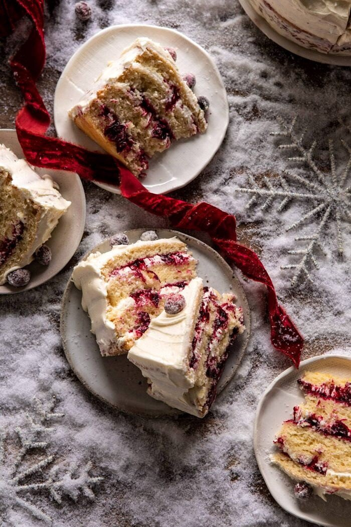 overhead photo of White Christmas Cranberry Layer Cake slices on dessert plates