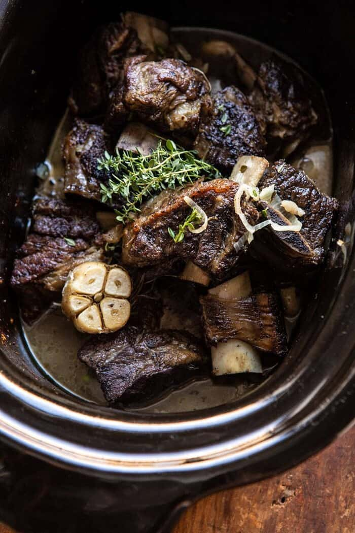overhead photo of White Wine Braised Short Ribs in crockpot bowl