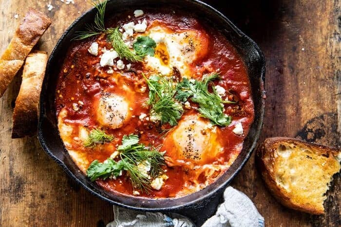 overhead horizontal photo of Eggs in Purgatory with Chile Butter and Feta