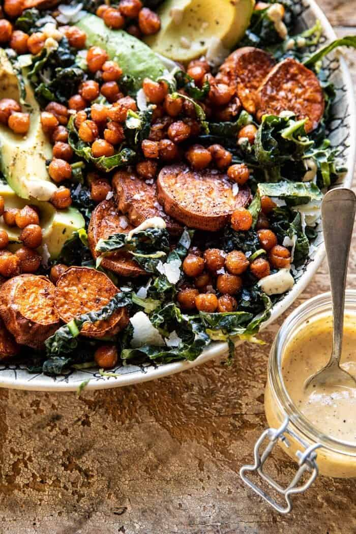 side angled close up photo of Kale Caesar Salad with Sweet Potatoes and Crispy Chickpeas