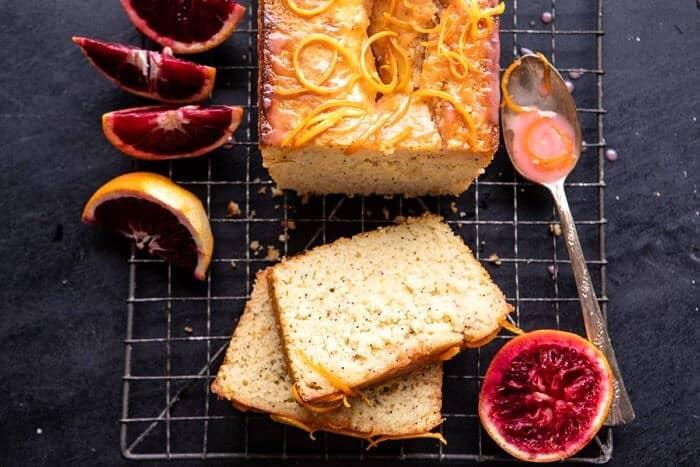 horizontal photo of Lemon Poppyseed Cake with Citrus Honey Glaze with 2 pieces of cake cut