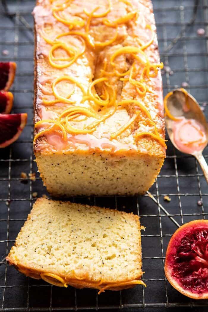 side angled photo of Lemon Poppyseed Cake with Citrus Honey Glaze with 1 piece of cake cut
