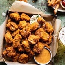 Oven Fried Cajun Popcorn Chicken with Creamy Honey Mustard | halfbakedharvest.com #chickenfingers #easyrecipes