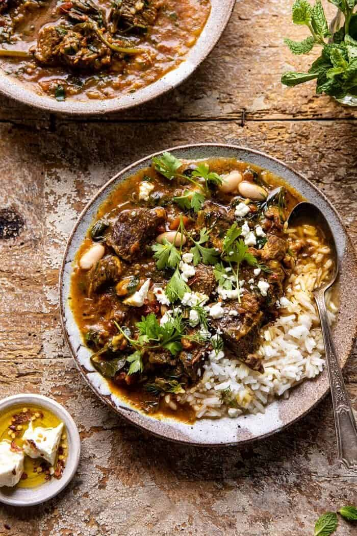 overhead close up photo of Persian Herb and Beef Stew with spoon in bowl