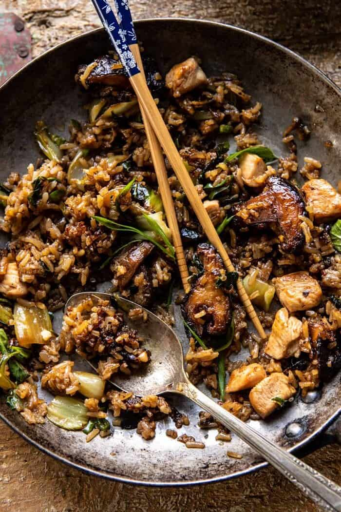 overhead photo of Better Than Takeout Sesame Ginger Chicken Fried Rice with chopsticks in skillet to show the food has been eaten