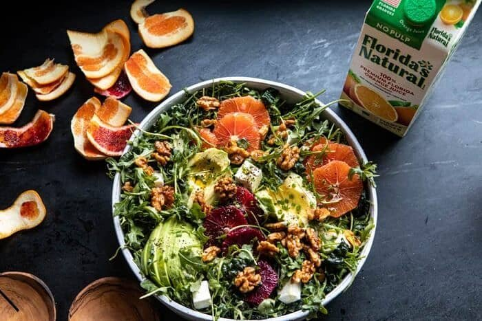 horizontal photo of Citrus Avocado Salad with Orange Tahini Vinaigrette