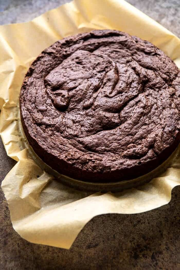 Flourless Chocolate Espresso Cake just after baking, sitting on parchment paper