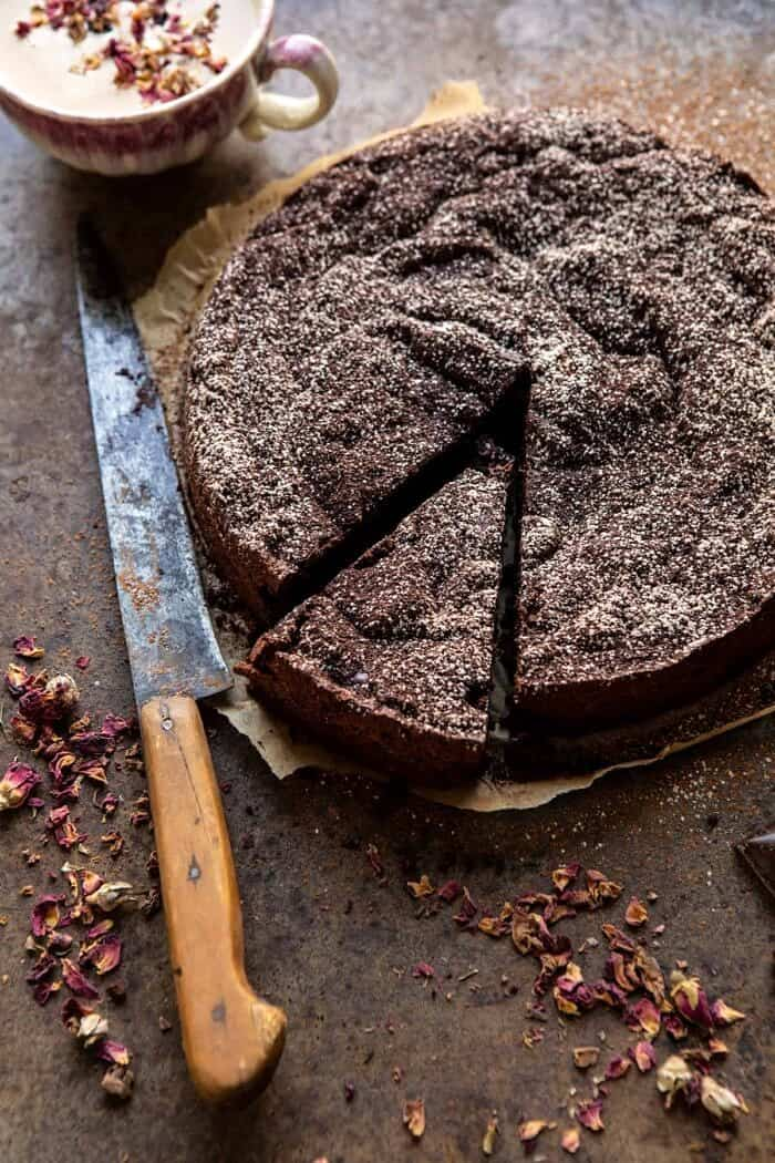overhead photo of Flourless Chocolate Espresso Cake with 1 slice cut