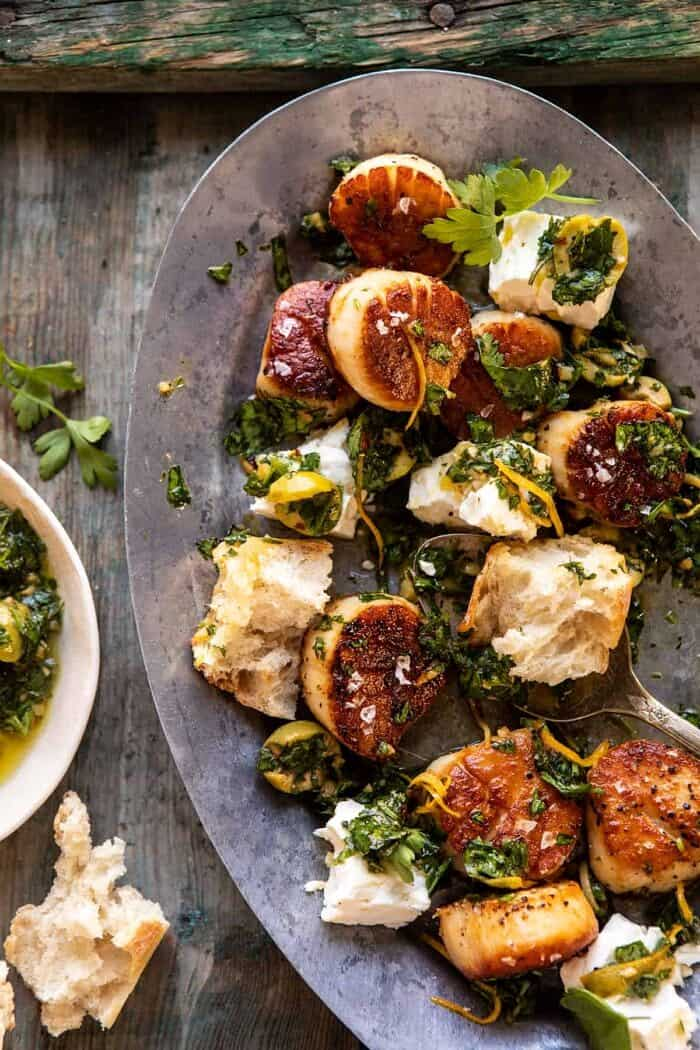 Herbed Garlic Butter Scallops with Lemony Feta Dressing with bread serving plate