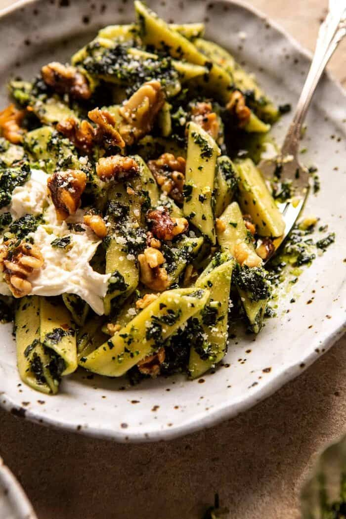 side angled photo of Herby Kale Pesto Pasta with Buttery Walnuts