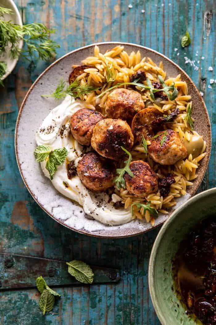 overhead close up photo of One Skillet Greek Meatballs and Lemon Butter Orzo