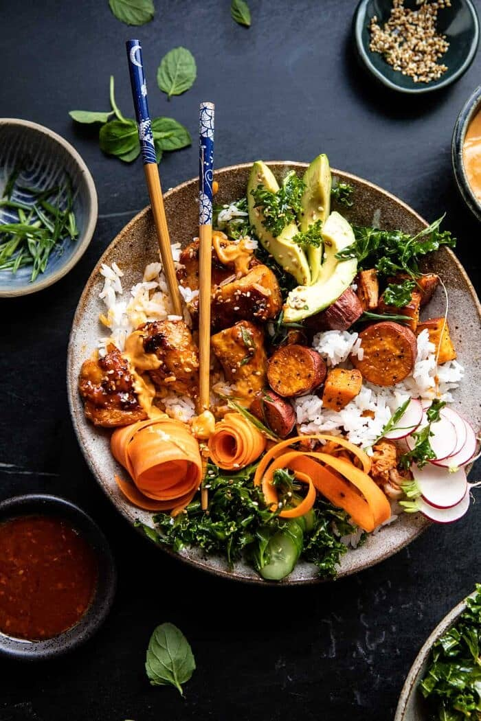 overhead photo of Sheet Pan Korean Chicken Bowl with Sweet Potatoes and Yum Yum Sauce with chop sticks in bowl