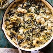 Skillet Baked Creamy Pesto Spinach and Artichoke Gnocchi.