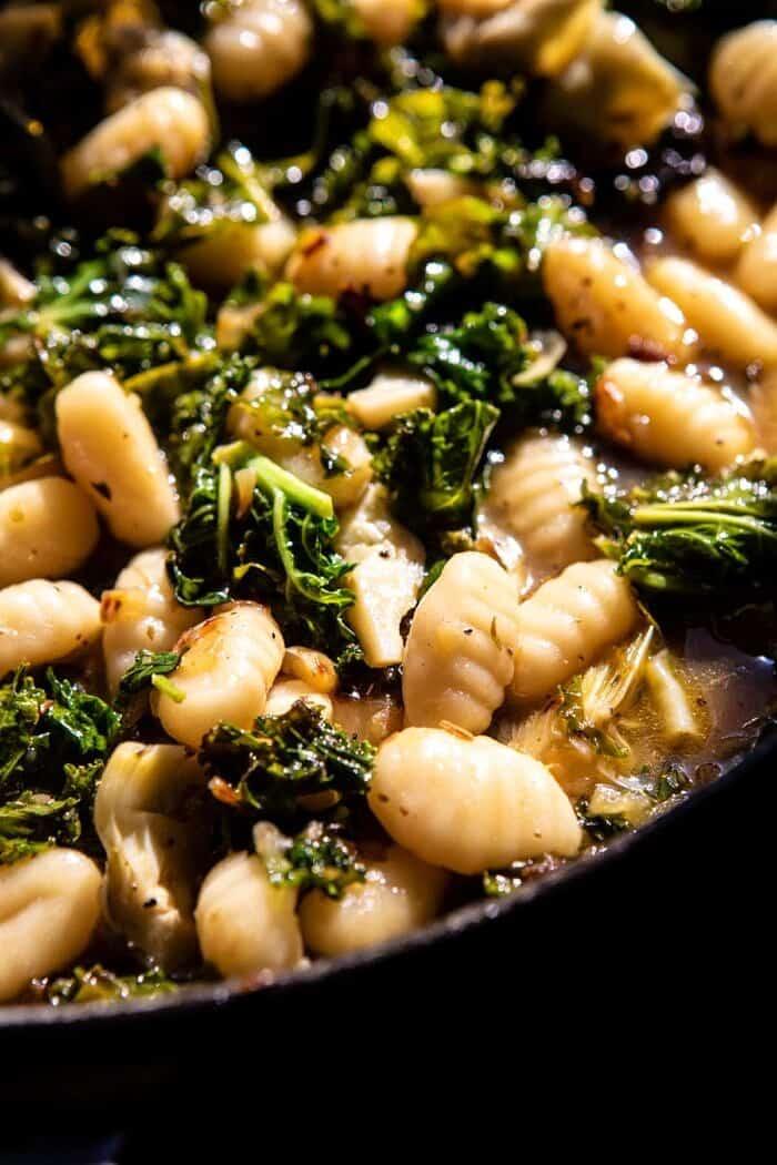 gnocchi cooking in sauce