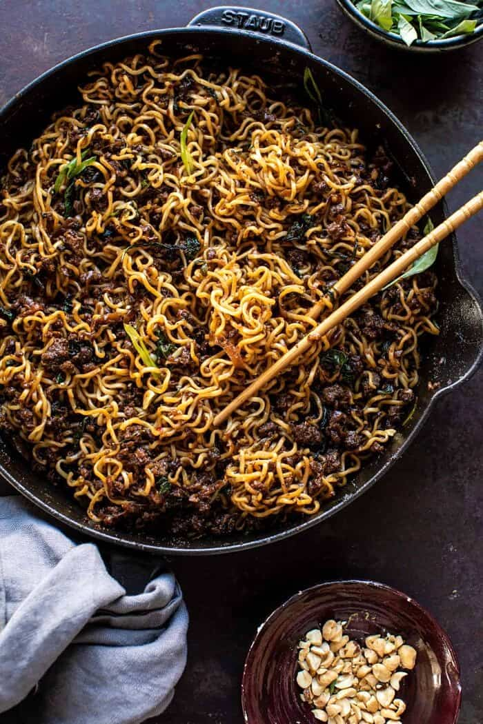 overhead photo of 30 Minute Caramelized Shallot Beef Ramen Noodles in skillet with chopsticks
