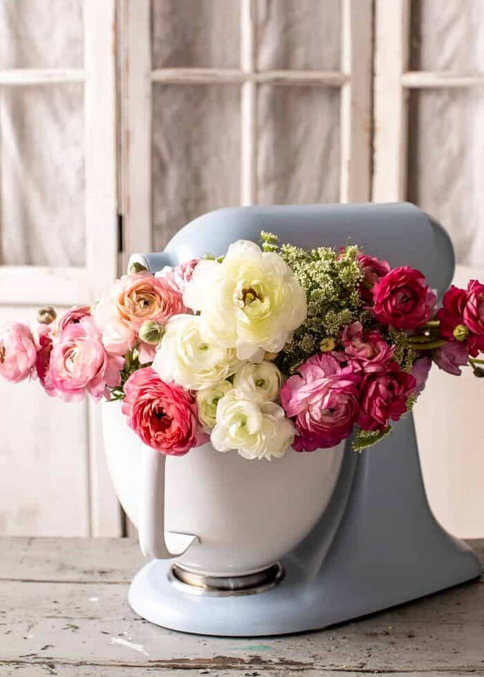 stand mixer filled with ranunculus