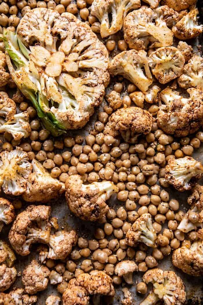 Cauliflower and chickpeas on baking sheet before roasting