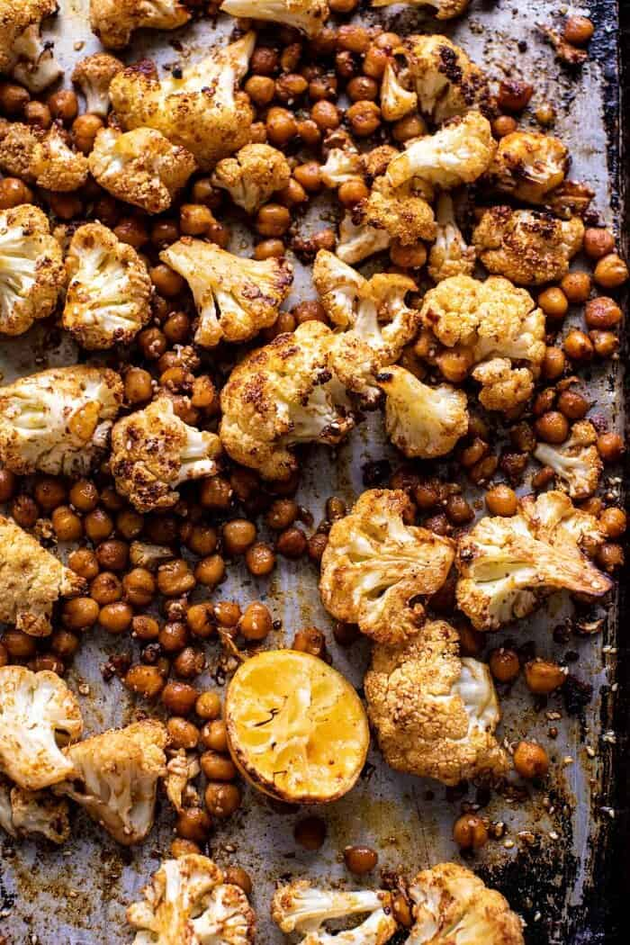 Cauliflower and chickpeas on baking sheet after roasting