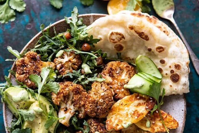 overhead close up horizontal photo of Cauliflower Shawarma with Green Tahini and Fried Halloumi