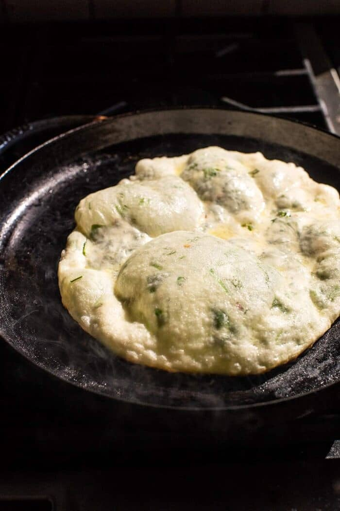 prep photo of Cheesy Herb Stuffed Naan cooking on skillet