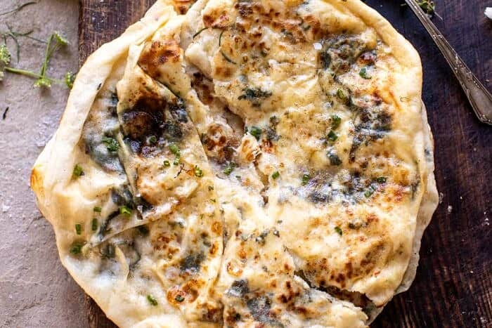 overhead horizontal photo of Cheesy Herb Stuffed Naan