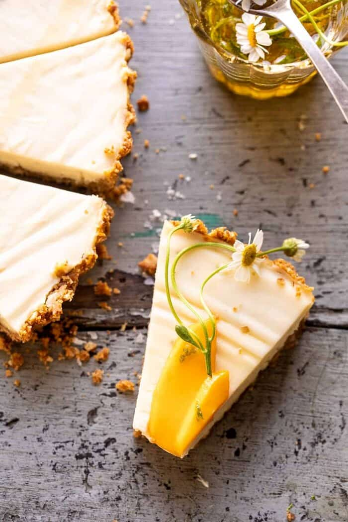 overhead close up photo of No Fuss Coconut Lime Tart slice with a bite taken out of the slice