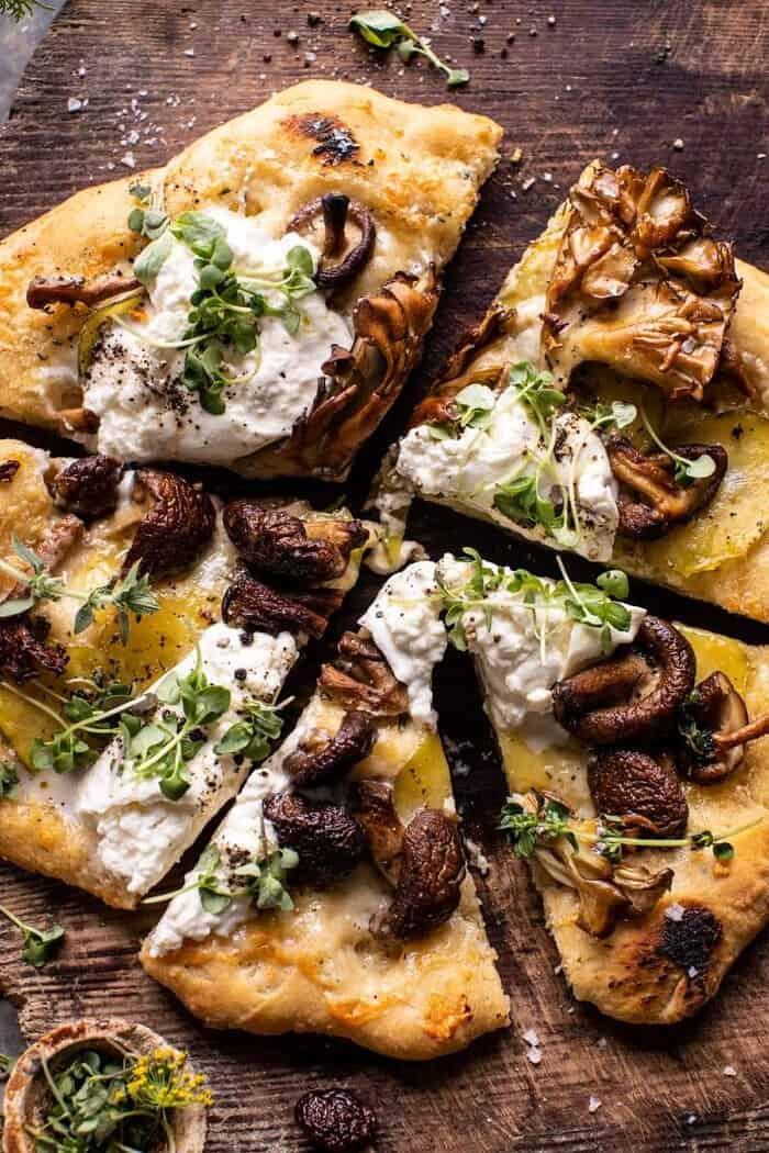 overhead close up photo of Potato and Wild Mushroom Burrata Pizza with pizza cut into slices