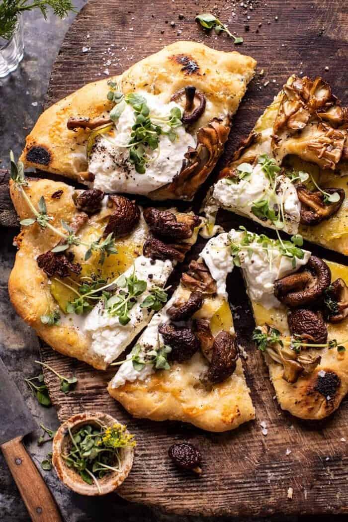 overhead photo of Potato and Wild Mushroom Burrata Pizza with pizza cut into slices