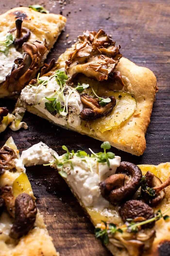 side angled photo of Potato and Wild Mushroom Burrata Pizza slices