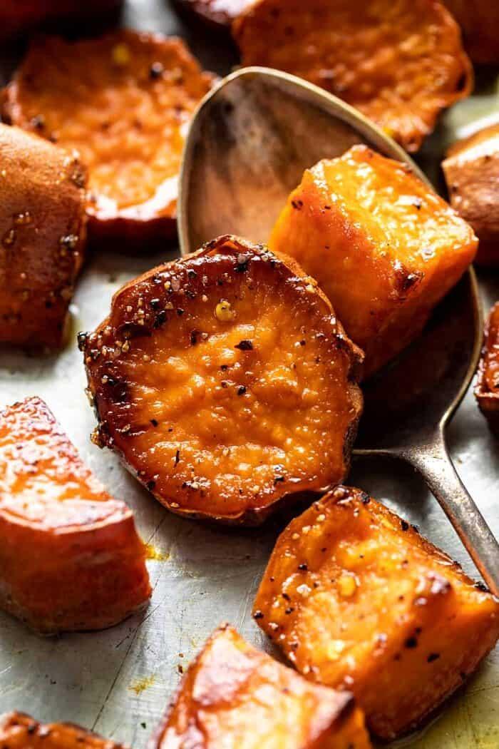 Honey'd Sweet Potatoes after roasting sitting on sheet pan