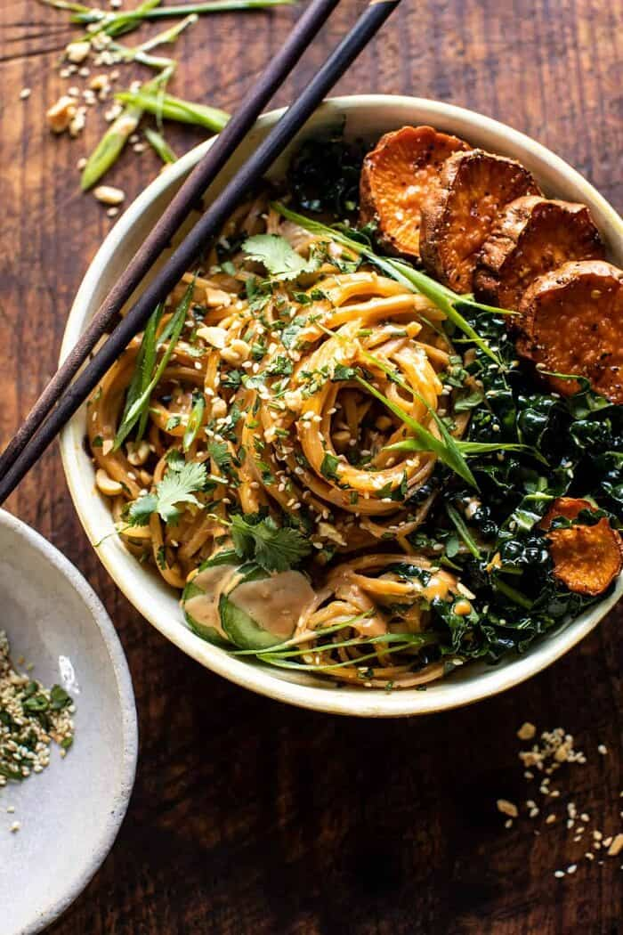 overhead close up photo of Saucy Tahini Noodles with Honey'd Sweet Potatoes