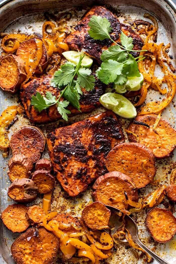 overhead photo of Sheet Pan Chipotle Salmon with sweet potatoes and bell peppers