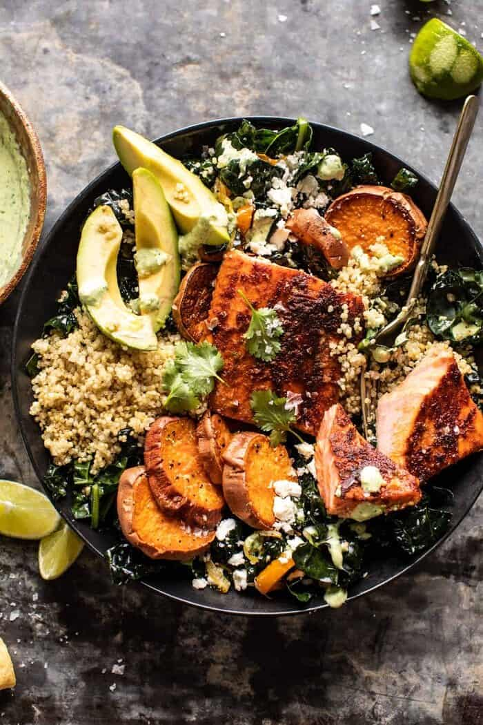 overhead photo Sheet Pan Chipotle Salmon with Cilantro Lime Special Sauce with fork in bowl