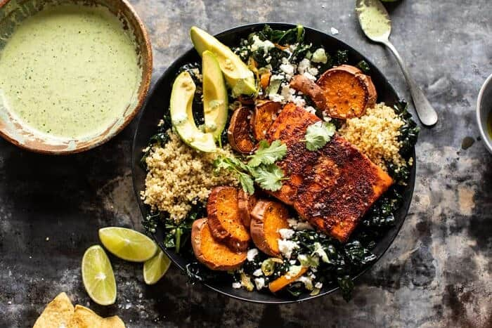 overhead horizontal photo of Sheet Pan Chipotle Salmon with Cilantro Lime Special Sauce | halfbakedharvest.com