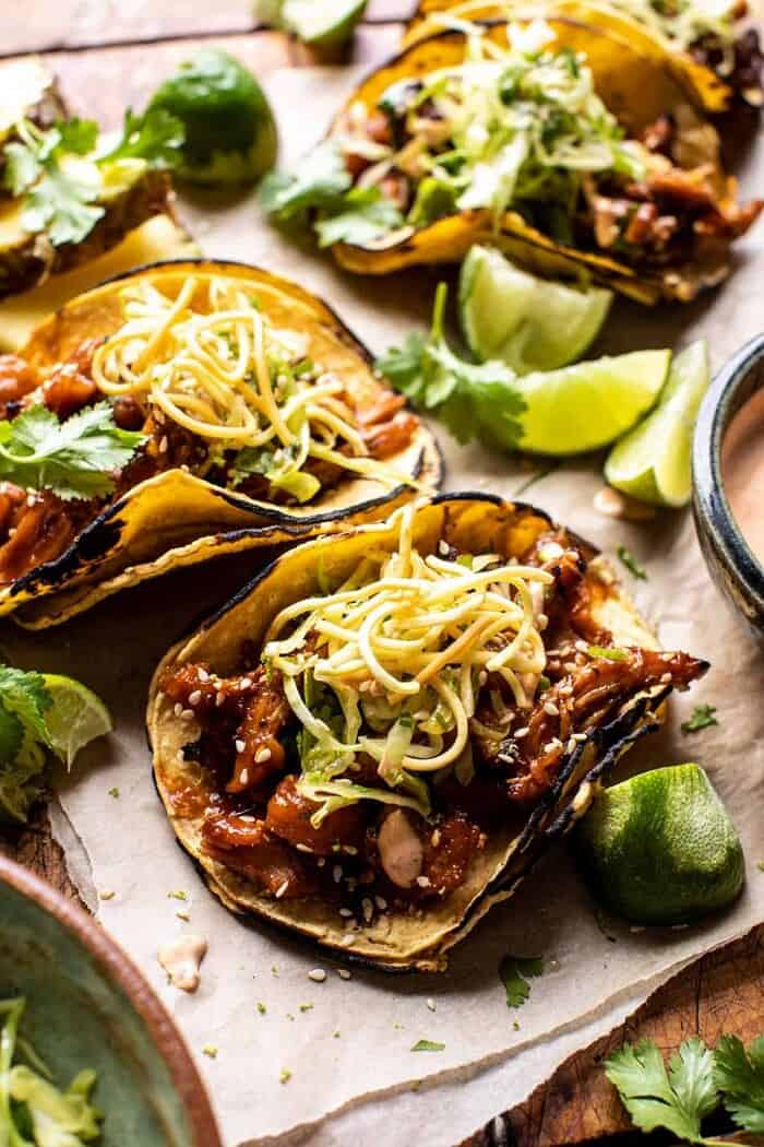 side angled photo of Slow Cooker Braised Hawaiian Pineapple Chicken Tacos